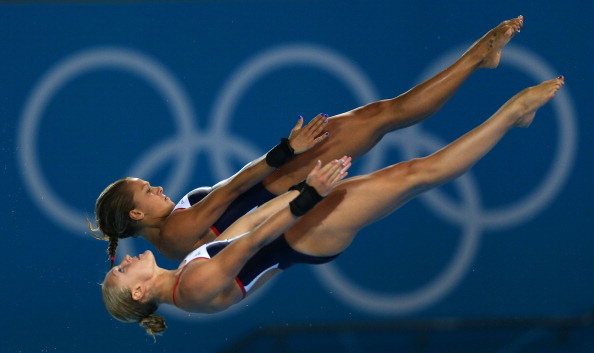 LONDON, ENGLAND - JULY 31: Sarah Barrow (foreground) and Tonia Couch of Great Britain compete in the Women's Synchronised 10m Platform Diving on Day 4 of the London 2012 Olympic Games at the Aquatics Centre on July 31, 2012 in London, England. (Photo by Clive Rose/Getty Images)